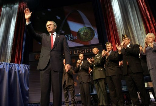 """President George W. Bush addresses the 85th Annual American Legion Convention in St. Louis, Mo., Tuesday, Aug. 26, 2003. """"In the 20th century, the American flag and the American uniform stood for something unique in history,"""" President Bush said in his remarks. """"America's armed forces humbled tyrants and raised up and befriended nations that once fought against us."""" White House photo by Paul Morse."""