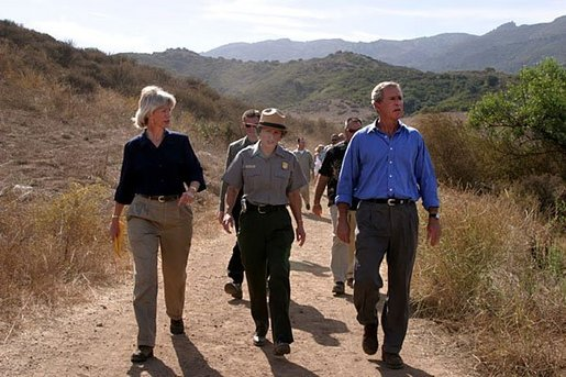 President George W. Bush walks with Secretary of the Interior Gale Norton, left, and Director of the National Park Service Fran Mainella at the Santa Monica Mountains National Recreation Area in Thousand Oaks, Calif. File photo. White House photo by Paul Morse.