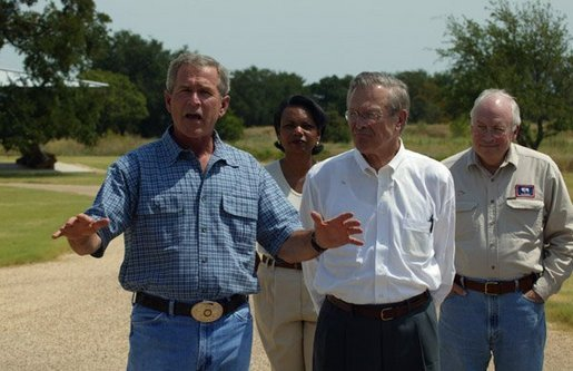 President George W. Bush and Secretary of Defense Donald Rumsfeld, accompanied by Vice President Dick Cheney and National Security Advisor Condoleezza Rice, answer questions from members of the media outside the President's Crawford, Texas, home Friday, Aug. 8, 2003. White House photo by David Bohrer