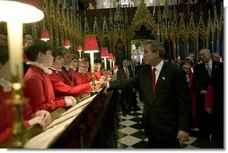After listening to the Westminster Abbey Choir perform, President George W. Bush greets one of the younger choir members during his and Mrs. Bush's tour of the abbey Thursday, Nov. 20, 2003.  White House photo by Eric Draper
