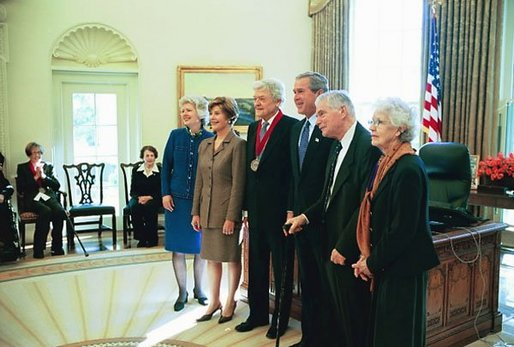 President George W. Bush and Laura Bush pose for a photo with actor Hal Holbrook, center, one of the National Humanities Medal Award recipients, during a ceremony in the Oval Office Friday, Nov. 14, 2003. White House photo by Susan Sterner.