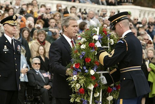 """Honoring those who died in service to America, President George W. Bush lays a wreath at the Tomb of the Unknowns in Arlington Cemetery on Veterans Day Nov. 11, 2003. After the wreath was placed, """"Taps"""" was played and a moment of silence was observed. White House photo by Paul Morse."""
