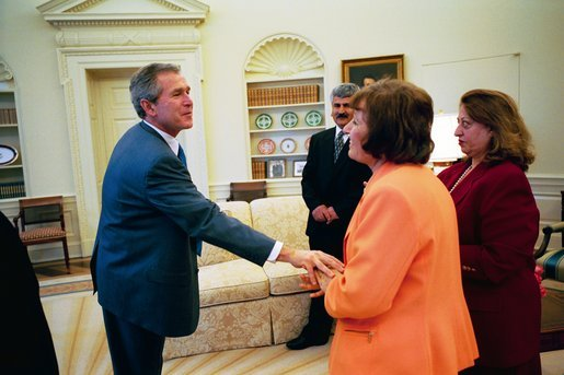 President George W. Bush says good bye to Dr. Katrin Michael, foreground, Della Jaff and Idres Hawarry in the Oval Office Friday, March 14, 2003, after speaking with them. The three are from the Kurdish area of Iraq where a chemical weapons attack killed 5,000 citizens 15 years ago this weekend. Thousands died in the days following the attack on Halabja and an estimated 10,000 people still suffer from the attack. Idres Hawarry survived the attack on Halabja, Dr. Michael survived a similar attack in another Kurdish village and friends and family of Della Jaff were killed in Halabja. White House photo by Eric Draper.