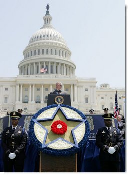 President George W. Bush addresses his remarks at the annual Peace Officers' Memorial Service outside the U.S. Capitol Tuesday, May 15, 2007, paying tribute to law enforcement officers who were killed in the line of duty during the previous year and their families. White House photo by Joyce N. Boghosian