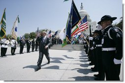 President George W. Bush salutes the color guard as he arrives at the annual Peace Officers' Memorial Service outside the U.S. Capitol Tuesday, May 15, 2007, paying tribute to law enforcement officers who were killed in the line of duty during the previous year and their families. White House photo by Joyce N. Boghosian