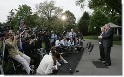 """President George W. Bush and President Alvaro Uribe of Colombia, deliver statements Wednesday, May 2, 2007, on the South Lawn of the White House. In introducing President Uribe to the media, President Bush said, """"It's been my honor to welcome a true democrat, a strong leader, and a friend.""""  White House photo by Joyce N. Boghosian"""