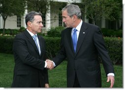 President George W. Bush and Colombia's President Alvaro Uribe exchange handshakes after delivering remarks Wednesday, May 2, 2007, on the South Lawn. President Uribe's visit underscores the friendship and extensive cooperation between the two countries. White House photo by Joyce N. Boghosian