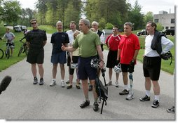 """President George W. Bush stands with member of the President's Council on Physical Fitness and Sports as he addresses the press before a bike ride in Beltsville, Md., Saturday, May 5 , 2007. """"Today I'm going to ride with a group of friends on a mountain bike,"""" said the President in his remarks about May being Physical Fitness Month, """"But the message to all Americans is to find time in your schedule to walk, run, swim, bike, to take care of yourselves."""" White House photo by Joyce N. Boghosian"""