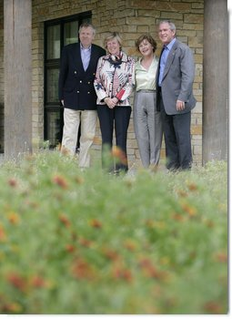 """President George W. Bush and Laura Bush stand with NATO Secretary-General Jaap de Hoop Scheffer and his wife Jeannine de Hoop Scheffer Monday, May 21, 2007, at the Bush Ranch in Crawford, Texas. """"The Secretary General of NATO has been a strong advocate of fighting terror, spreading freedom, helping the oppressed and modernizing this important alliance,"""" said the President in his remarks to the press. White House photo by Eric Draper"""