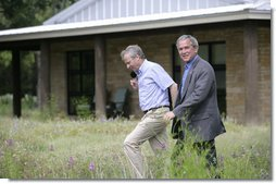 President George W. Bush and NATO Secretary-General Jaap de Hoop Scheffer walk the grounds of the Bush Ranch in Crawford, Texas Monday, May 21, 2007. During the two-day visit, the leaders discussed a variety of issues including Afghanistan and missile defense.  White House photo by Shealah Craighead