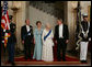 President George W. Bush and Mrs. Laura Bush escort Her Majesty Queen Elizabeth II and His Royal Highness The Prince Philip, Duke of Edinburgh, from the Grand Staircase of the White House Monday, May 7, 2007, prior to attending the State Dinner in the Queen's honor. White House photo by Lynden Steele