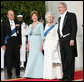 President George W. Bush and Mrs. Laura Bush welcome Her Majesty Queen Elizabeth II and His Royal Highness The Prince Philip, Duke of Edinburgh, Monday, May 7, 2007, upon their arrival to the North Portico of the White House for a State Dinner in their honor. White House photo by Eric Draper