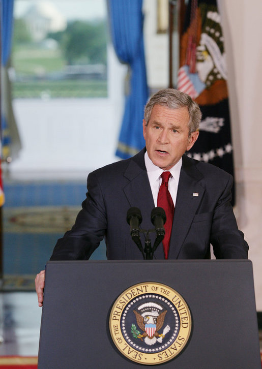 """President George W. Bush issues a statement Tuesday, May 1, 2007, regarding his veto of the Iraq War Supplemental. Speaking from Cross Hall in the White House, the President said, """"We need to give our troops all the equipment and the training and protection they need to prevail. The need to act is urgent."""" White House photo by Eric Draper"""