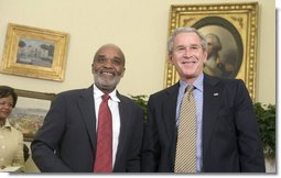 President George W. Bush and President Rene Preval of Haiti stand in the Oval Office Tuesday, May 8, 2007, during a photo opportunity with the media. The leaders were expected to discuss a range of issues, including recent efforts by the United Nations stabilization mission in Haiti to enhance security and opportunities for promoting growth and prosperity in Haiti.  White House photo by Joyce N. Boghosian