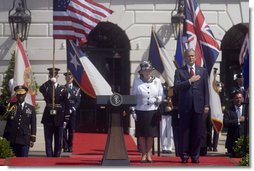 President George W. Bush stands with his hand over his heart during the playing of America's national anthem during the Arrival Ceremony for Her Majesty Queen Elizabeth II and His Royal Highness The Prince Philip Duke of Edinburgh Monday, May 7, 2007, on the South Lawn.  White House photo by Lynden Steele