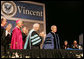 President George W. Bush is applauded by Saint Vincent College President Jim Towey, center, and Washington Archbishop Donald Wuerl as he is introduced on stage Friday, May 11, 2007, prior to delivering the commencement address at Saint Vincent College in Latrobe, Pa. White House photo by Joyce Boghosian