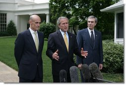 """President George W. Bush, center, joined by Homeland Security Secretary Michael Chertoff, left, and Commerce Secretary Carlos Gutierrez, right, makes a statement on immigration reform Thursday, May 17, 2007 on the South Lawn of the White House. """"I want to thank the members of the Senate who worked hard, said President Bush. """"I appreciate the leadership shown on both sides of the aisle. As I reflect upon this important accomplishment, important first step toward a comprehensive immigration bill, it reminds me of how much the Americans appreciate the fact that we can work together -- when we work together they see positive things.""""  White House photo by Joyce N. Boghosian"""