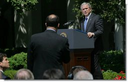 """President George W. Bush listens to a question Thursday, May 24, 2007, during a press conference in the Rose Garden. The President said, """"Today, Congress will vote on legislation that provides our troops with the funds they need. It makes clear that our Iraqi partners must demonstrate progress on security and reconciliation. As a result, we removed the arbitrary timetables for withdrawal and the restrictions on our military commanders that some in Congress have supported.""""  White House photo by Chris Greenberg"""