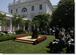 President George W. Bush responds to a reporter's question Thursday, May 24, 2007, during a morning press conference in the Rose Garden of the White House. White House photo by Joyce N. Boghosian