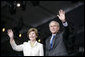 """President George W. Bush and Mrs. Laura Bush wave Sunday, May 13, 2007, as they arrive at Anniversary Park in Williamsburg, Va., where the President delivered a speech in celebration of the 400th anniversary of the Jamestown Settlement. """"Today we have no closer ally than the nation we once fought for our independence,"""" said the President. """"Britain and American are united by our democratic heritage, and by the history that began at this settlement 400 years ago."""" White House photo by Shealah Craighead"""
