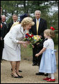 Mrs. Lynne Cheney receives a bouquet of flowers Friday, May 4, 2007, during a tour of Jamestown Settlement in Williamsburg, Virginia. White House photo by David Bohrer