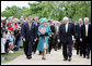 Vice President Dick Cheney accompanies Her Majesty Queen Elizabeth II of England Friday, May 4, 2007, on a tour of Jamestown Settlement in Williamsburg, Virginia. The Queen's visit comes during the 400th anniversary celebrations at Jamestown, the first permanent English settlement in North America. White House photo by David Bohrer