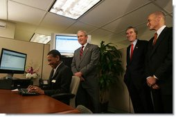 President George W. Bush is joined by Secretary Michael Chertoff, right, of the Department of Homeland Security, and Secretary Carlos Gutierrez of the Department of Commerce, as they look on during a demonstration Wednesday, May 16, 2007, of the Basic Pilot/Employment Eligibility Verification System, a voluntary program managed by U.S. Citizenship and Immigration Services that allows employers to electronically verify the eligibility of newly hired employees. The demonstration, led by Glenda Wooten-Ingram, Director of Human Resources, was held at the Embassy Suites Washington, D.C.-Convention Center, and was followed by a roundtable discussion of the program. White House photo by Joyce N. Boghosian
