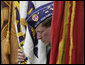 A flag bearer for the Military Order of the Purple Heart bows his head during the Memorial Day commemoration ceremony Monday, May 28, 2007, at Arlington National Cemetery in Arlington, Va. White House photo by Joyce Boghosian