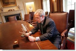President George W. Bush records his radio address for a Saturday morning broadcast in the Cabinet Room of the White House Thursday, March 17, 2005.  White House photo by Eric Draper