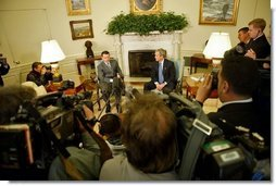 President George W. Bush and His Majesty King Abdullah of Jordan meet with reporters in the Oval Office Tuesday, March 15, 2004.  White House photo by Paul Morse