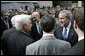 President George W. Bush and Secretary of Homeland Security Michael Chertoff greet the crowd at the Ronald Reagan Building and International Trade Center in Washington, D.C. after Chertoff's swearing-in ceremony Thursday, Mar. 3, 2005. White House photo by Paul Morse