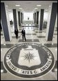 Walking through the main lobby, President George W. Bush and Porter Goss, director of the Central Intelligence Agency, head to a brief news conference at CIA headquarters Thursday, March 3, 2005, in Langley, Va. White House photo by Paul Morse