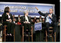 President George W. Bush talks with grandmother Margaret Valdez, center, and her granddaughter Jessica Valdez during a Conversation on Strengthening Social Security in Albuquerque, N.M., Tuesday, March 23, 2005.  White House photo by Eric Draper