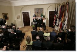 Irish Taoiseach Bertie Ahern delivers remarks before presenting President George W. Bush with the traditional bowl of shamrocks during a St. Patrick's Day Shamrock Ceremony in the Roosevelt Room Thursday, March 17, 2005.  White House photo by Paul Morse