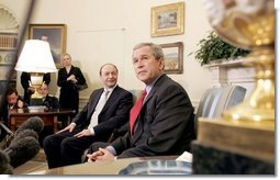 President George W. Bush and Romanian President Traian Basescu take questions from the media in the Oval Office Wednesday, March 9, 2005.  White House photo by Paul Morse