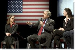President George W. Bush discusses his proposal to reform Social Security with University of Louisville students Lindsey Mottley, left, and Rebecca Dean, right, in Louisville, Ky., Thursday, March 10, 2005.  White House photo by Paul Morse