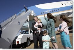 President George W. Bush waves from Air Force One during a visit to Shreveport, La., Friday, March 11, 2005.  White House photo by Paul Morse