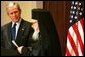 President George W. Bush listens as Archbishop Demetrios Trakatellis delivers brief remarks Monday, March 28, 2005, during a celebration of Greek Independence Day at the Eisenhower Executive Office Building in Washington DC.White House photo by Krisanne Johnson