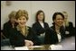 """Laura Bush and Secretary of State Condoleezza Rice laugh during a roundtable discussion with women leaders from around the world held in honor of International Women's Day at the State Department in Washington, D.C. Tuesday, March 8, 2005. Today in her remarks at the State Department Mrs. Bush said, """"We all have an obligation to speak for women who are denied their rights to learn, to vote or to live in freedom. We may come from different backgrounds, but advancing human rights is the responsibility of all humanity, a commitment shared by people of goodwill on every continent."""" White House photo by Susan Sterner"""