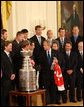 President George W. Bush thanks Detroit Red Wings player Chris Chelios for a miniature Stanley Cup presented to the President Tuesday, Oct. 14, 2008 in the East Room at the White House, during the ceremony to honor the Red Wings 2008 Stanley Cup championship. White House photo by Chris Greenberg