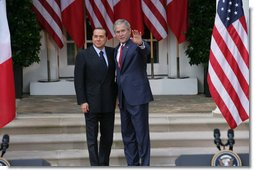 """President George W. Bush and Italian Prime Minister Silvio Berlusconi stand together following their remarks at a joint press availability Monday, Oct. 13, 2008, at the White House. President Bush said, """"I want to thank you for giving the American People the honor of celebrating Columbus Day with the leader of Italy."""" White House photo by Chris Greenberg"""