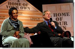 President George W. Bush speaks during a discussion about homeownership with first-time homebuyer Pearl Cerdan in Ardmore, Pennsylvania. Monday, March 15, 2004.  White House photo by Tina Hager