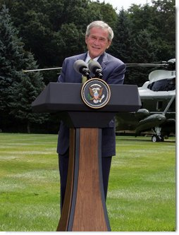 President George W. Bush addresses the press during a joint press availability with British Prime Minister Gordon Brown Monday, July 30, 2007, at Camp David near Thurmont, Md. White House photo by Chris Greenberg