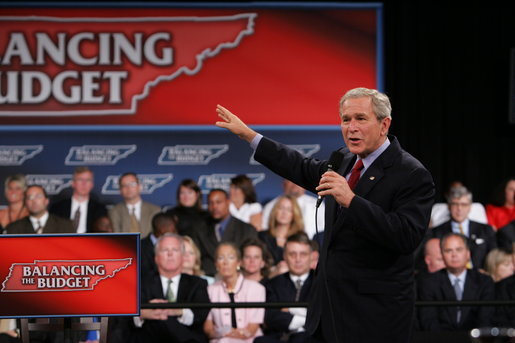 "President George W. Bush gestures as he addresses the audience at the Gaylord Opryland Resort and Convention Center Thursday, July 19, 2007 in Nashville, Tenn. Speaking about the economy and budget issues President Bush said, ""The best way to balance the budget is to keep taxes low."" White House photo by Chris Greenberg"