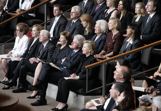 """Mrs. Laura Bush, first row-center, joins former President Jimmy Carter and his wife, Rosalynn; former President Bill Clinton, and his wife, Hillary Clinton; Mrs. Nancy Reagan; Caroline Kennedy Schlossberg, her husband Edwin Schlossberg; Mrs. Barbara Bush; Susan Ford Bales, daughter of former President Gerald R. Ford; and Patricia """"Tricia"""" Nixon Cox and her husband, Edward Cox, upper-right, at the funeral service for former first lady Lady Bird Johnson Saturday, July 14, 2007, at the Riverbend Centre in Austin, Texas. White House photo by Shealah Craighead"""