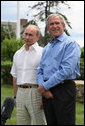 """President George W. Bush stands with President Vladimir Putin, prior to the Russian leader's departure Monday, July 2, 2007, from Kennebunkport, Me. Said President Bush, """"When Russia and the United States speak along the same lines, it tends to have an effect and therefore I appreciate the Russians' attitude in the United Nations. We're close on recognizing that we got to work together to send a common message."""" White House photo by Eric Draper"""