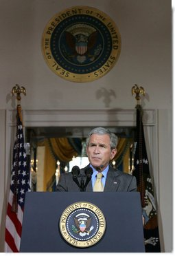 """President George W. Bush delivers remarks on the Middle East Monday, July 16, 2007, in the Cross Hall. """"This year, we will provide the Palestinians with more than $190 million in American assistance -- including funds for humanitarian relief in Gaza,"""" said the President. """"To build on this support, I recently authorized the Overseas Private Investment Corporation to join in a program that will help generate $228 million in lending to Palestinian businesses."""" White House photo by Joyce N. Boghosian"""