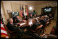 President George W. Bush meets with members of his National Security team Friday, July 13, 2007, in the Roosevelt Room at the White House during a video teleconference with Iraq Provincial Recontsruction Team Leaders, Embedded Provincial Reconstruction Team Leaders and Brigade Combat Commanders. White House photo by Eric Draper
