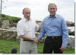 """President George W. Bush and President Vladimir Putin of Russia, shake hands at the end of their joint press availability Monday, July 2, 2007, at Walker's Point in Kennebunkport, Me. Said President Bush, """"We had a good, casual discussion on a variety of issues. We had a very long, strategic dialogue that I found to be important, necessary and productive.""""  White House photo by Joyce N. Boghosian"""