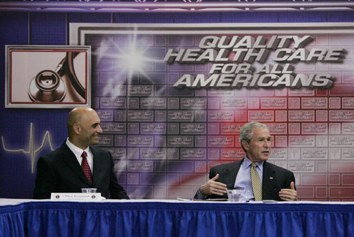 President George W. Bush talks with Clifton Broumand, CEO of Man & Machine, Inc. during in a roundtable discussion about health care initiatives after touring Mr. Broumand's company Wednesday, July 18, 2007, in Landover, Md. White House photo by Chris Greenberg